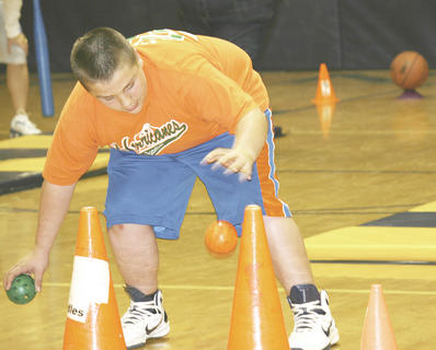 Hunter Lawson tries to place balls on top of cones in the relay against teachers.