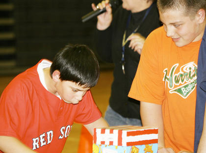 Jeremiah Rice chews gum and then struggles to blow a bubble in the final task of the relay as Hunter Lawson watches.