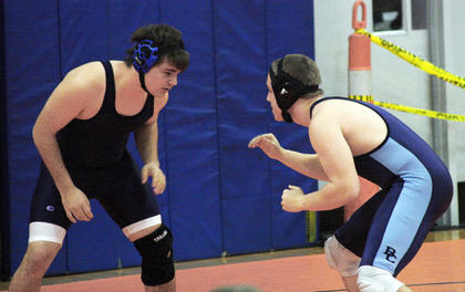 Issac Magee looks for a move against his Boone County opponent.