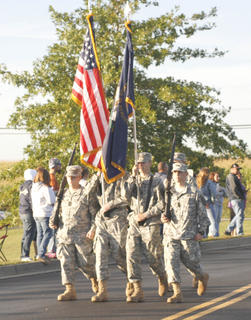 The Grant County High School JROTC Honor Guard lead the way in the procession of the parade.