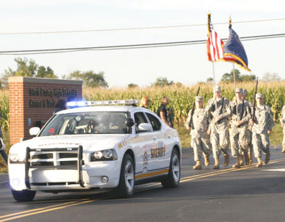 The GCHS JROTC Honor Guard follow a Grant County Sheriff's car.