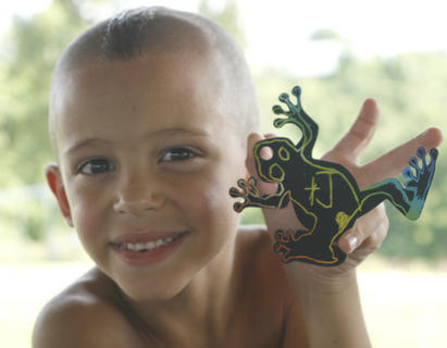 Jackson Coleman Shows the frog he designed during craft time.