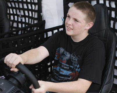 Jacob Martin, of Falmouth, races in the simulator at Wal-Mart in Dry Ridge.