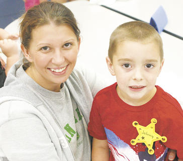 Johnny Scherder smiles with his mother Jamie on his first day of kindergarten at MCE.