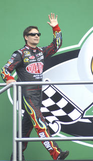 Jeff Gordon walks on stage during racer introductions at the Kentucky Speedway.