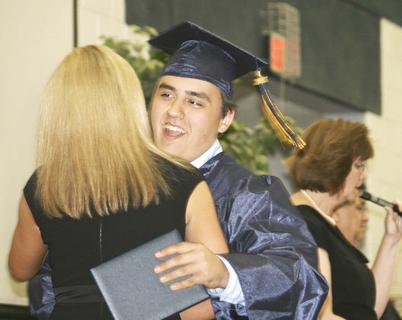 Jeremiah Claypool Goins gives Principal Claudette Herald one last hug.