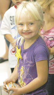 Jeweli Flege chooses chocolate milk for her first day of school at Mason-Corinth Elementary.