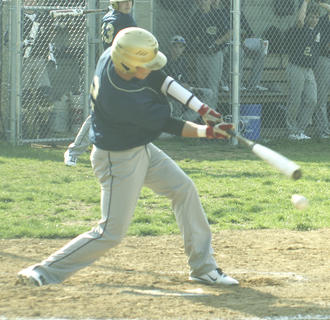 Jordan Martin ropes a single down the third-base line against Williamstown March 20.