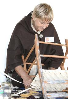 Judy Mullins demonstrates the art of chair weaving.