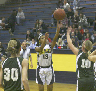 Seventh grader Justice Arce shoots a jump shot against St. Pius Jan. 30 at Grant County Middle School.