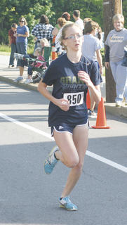 Kaitlyn Howard was the first female runner to finish the Derby Dash 5K May 7 in Williamstown.