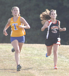 Lady Demons senior Katie Butler races to the finish during the North Central Kentucky Conference meet at Williamstown High School Aug. 31.