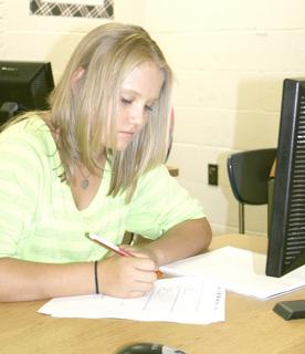 Kayla Haubner, an eighth grade student at Grant County Middle School, takes a pre-test in Angela Cummin's technology class.