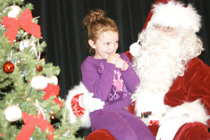 Kennedy Riess, 7, of Dry Ridge ponders what to tell Santa she wants for Christmas.