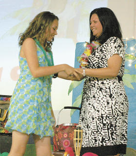 Kiara Clay receives her diploma from principal and mother Heather Clay at graduation May 23.