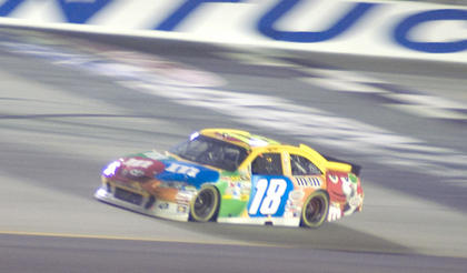"Kyle Busch races his No. 18 car at the Kentucky Speedway July 9 in the inaugural ""Quaker State 400."" Busch led 125 of the 267 laps."