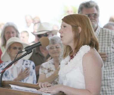 Leannda Drysdale, a fourth grade teacher at Williamstown Elementary School, sings the National Anthem.