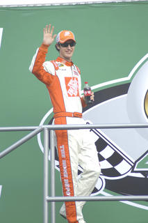 Joey Logano walks on stage during the racer introductions.