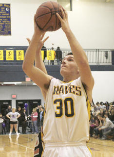 Luke ONan shoots a jump shot against the Demons.