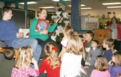 "Cheryl Clemons reads the Christmas classic, ""Twas the Night Before Christmas,"" by Clement Moore, at the Mason-Corinth Elementary Holiday Cafe."