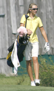 GCHS freshman Macy Wright carries her bag on hole number 1 Aug. 17 against St. Henry.