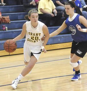 Lady Braves freshman guard Macy Wright goes to the basket against a Lady Eagles defender.
