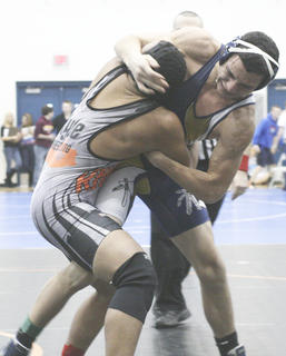 Malcolm Willoughby works on taking down the Ryle opponent at the Region 6 Wrestling Tournament at Boone County High School Feb. 10.