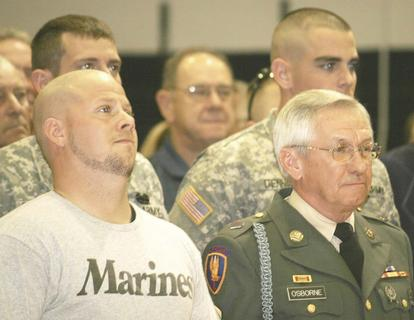 Veterans Chaz Matthews, left, and John Osborne, right, spoke during a Veterans Day assembly at GCMS.