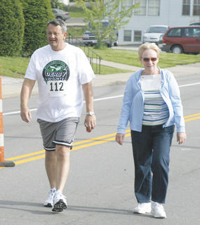 Williamstown Mayor Rick Skinner and Pam Workman walk the Derby Dash 5K.