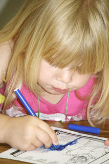 Mekaylah Wagers concentrates on coloring at Grant County Church of Christ Vacation  Bible School.