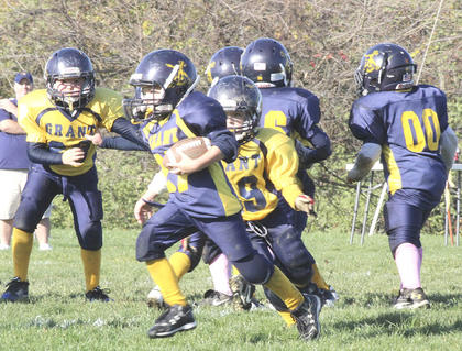 Michael Harmeyer tries to gain some yardage against the Gold Midgets Oct. 22. The Gold Midgets will represent Grant County in the Superbowl.