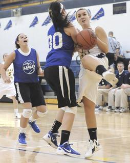 Lady Braves senior forward grimaces as she is fouled on the shot.