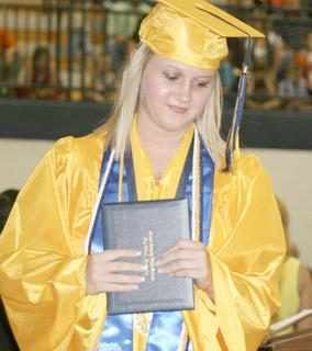 Haley Mullins walks away with her diploma.