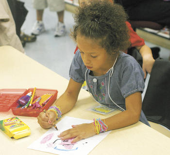 Mya Burchett learns the color red during the first day of school in Mrs. Forman's kindergarten class.