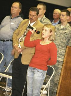 Madison Pelfrey, a sixth grader at Grant County Middle School, sings the national anthem during a Veterans Day assembly at the school.