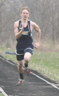 Braves sophomore long jumper Nathan Davis begins his trek for his first jump at the Grant County, Owen County, Pendleton County, Walton-Verona Gold Medal Event March 24.