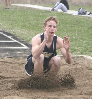 Davis lands in the dirt pit.