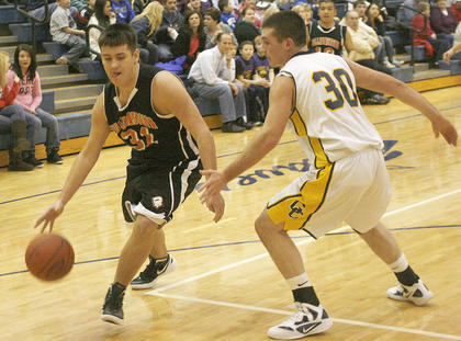 Nick Switzer drives to the basket against Luke O'Nan.