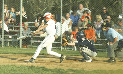 Clint Moore lines a single against the Braves in the top of the fourth inning.