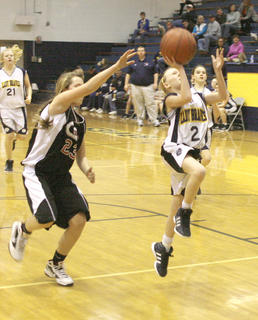 Sixth grader Haley Gifford leaps for the shot against Conner Middle School Jan. 19
