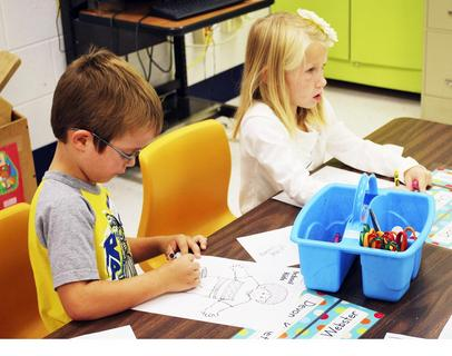 Dry Ridge Elementary students Devon Kinnett and Chelsea Jones color a picture. Photo by Camille McClanahan
