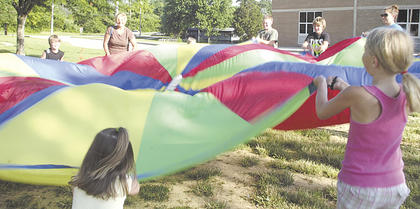 Grant County Parks and Recreation hosted a Backyard Game Night at Crittenden Mt. Zion Elementary where a parachute was popular during one of the games.