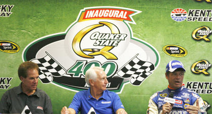Governor Steve Beshear holds a press conference at the Kentucky Speedway along with Owensboro natives Michael and Darrell Waltrip.