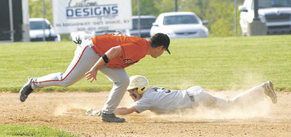 Braves left fielder Roman Jaconette steals second base, avoiding the tag by Demons second basemen Lee Boone.