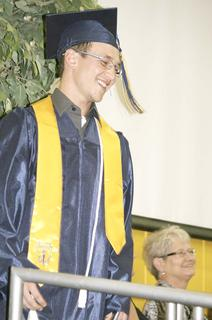 Roman Jaconette smiles after receiving his diploma.