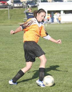 Sammie Souder dribbles the ball down the field.