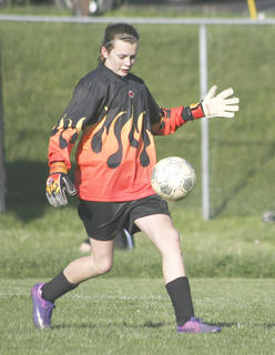 Rachel Montgomery performs a goal kick.