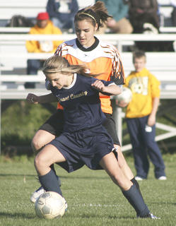 Lady Braves Courtney Faehr is defended by Williamstowns Sammie Souder.