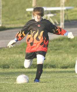 Demons goalkeeper Ashton Johnson prepares to do a goal kick after Grant County knocked the ball out of bounds.