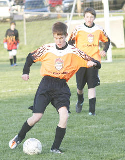 Demons Andrew Davis dribbles the ball down the field against Grant County April 10. The Demons lost 6-0 in the game.